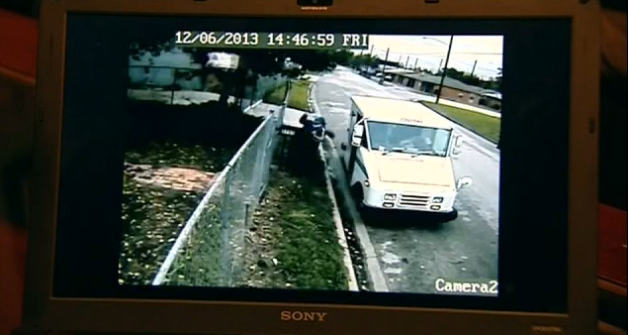 USPS Throws Package Over Fence