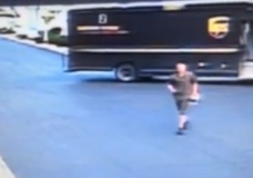 FedEx Brethren: UPS Man Throwing Package Over Fence