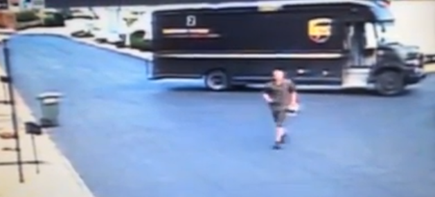 UPS Throwing Package Over Fence