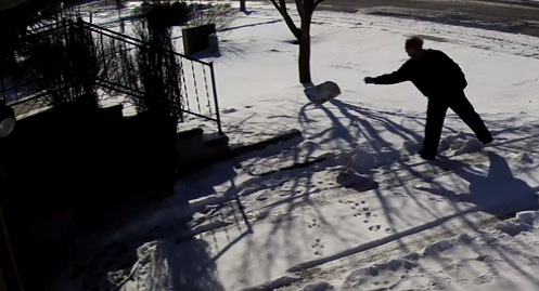 Postal worker throwing package into snow