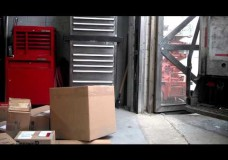 UPS Tossing Multiple Packages Into a Warehouse