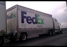 FedEx Semi Truck Pushes Package Down the Highway