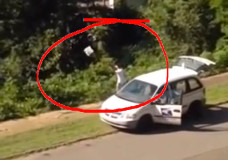 Postal worker throwing packages into a ravine in Birmingham, Alabama.